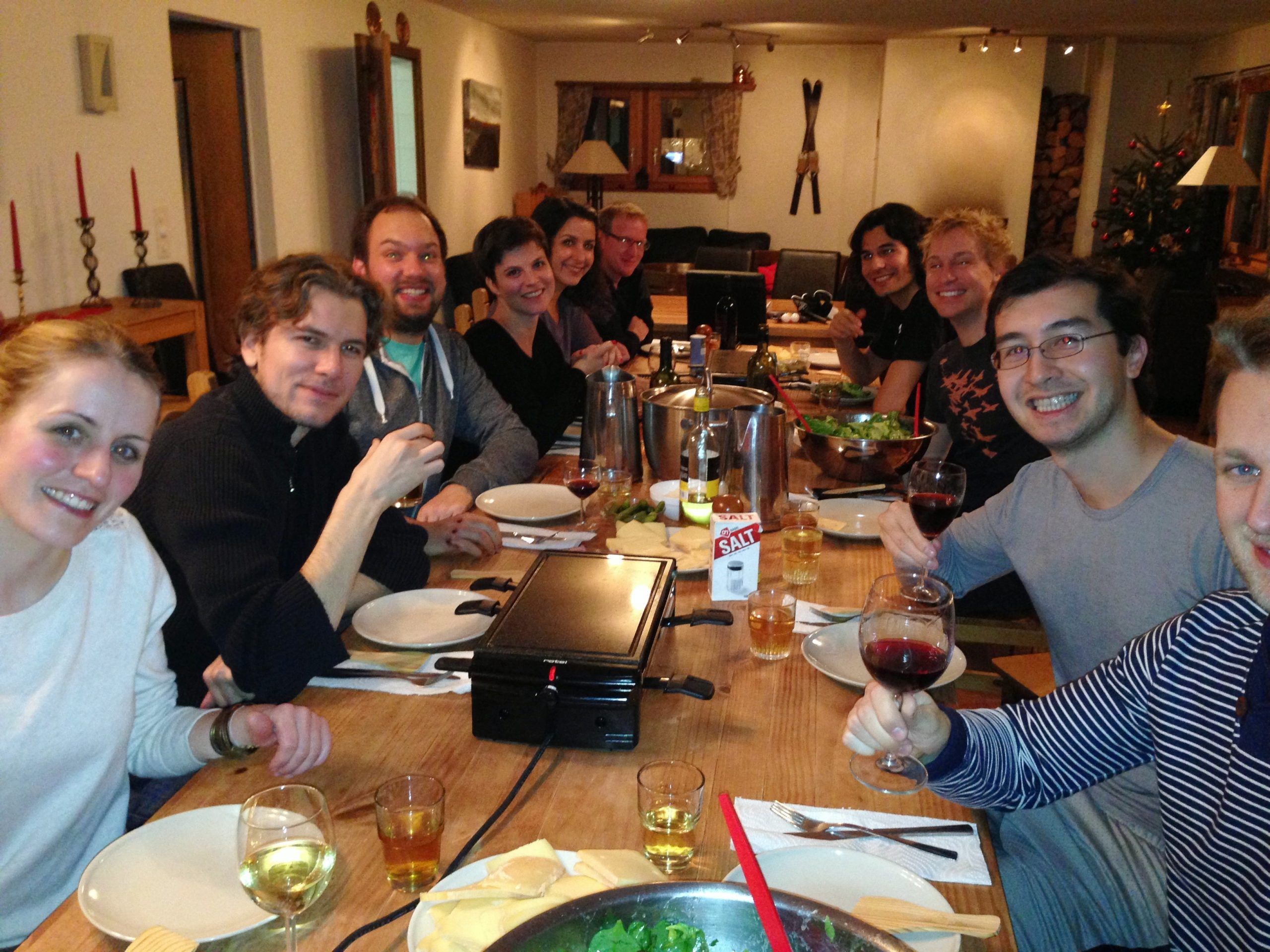 Group dines together spreading cheer around.
